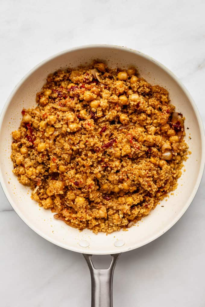 A white pan with sun-dried tomato quinoa in it