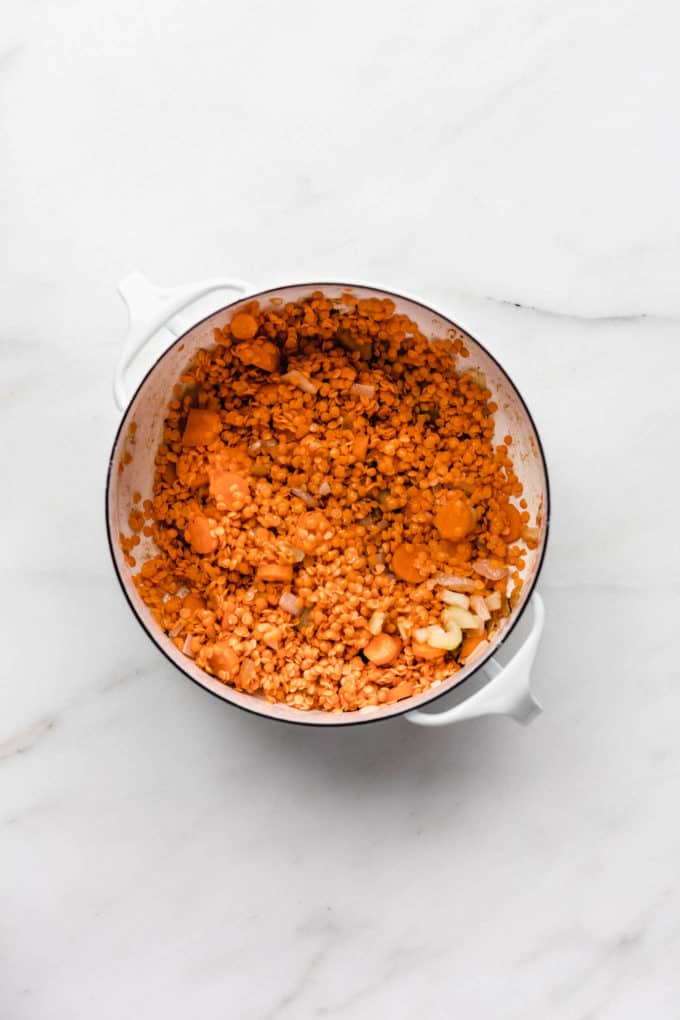 red lentils and carrots in a white pot