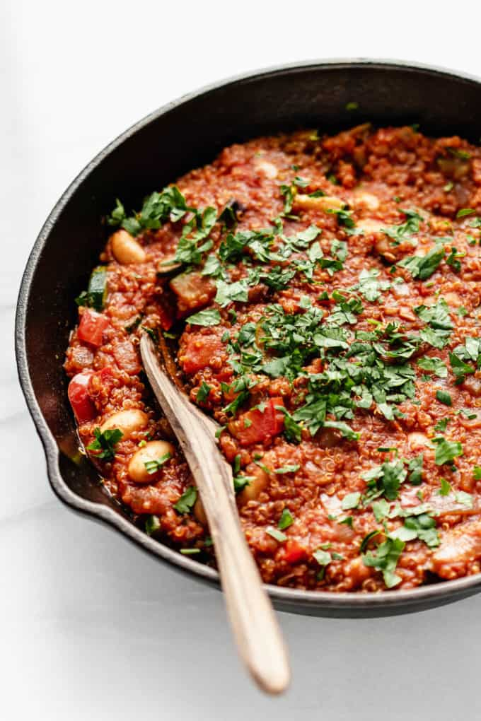 A close up of vegan shakshuka topped with parsley