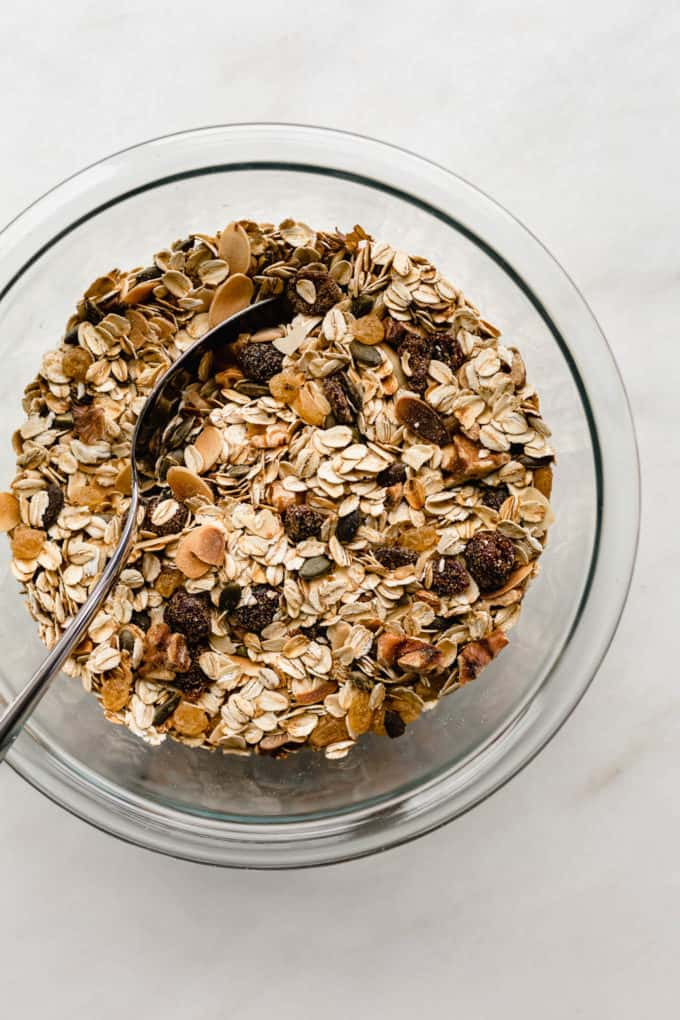 A clear mixing bowl filled with toasted muesli