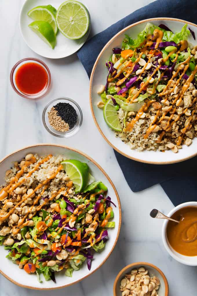 Two buddha bowl with quinoa, salad and tempeh