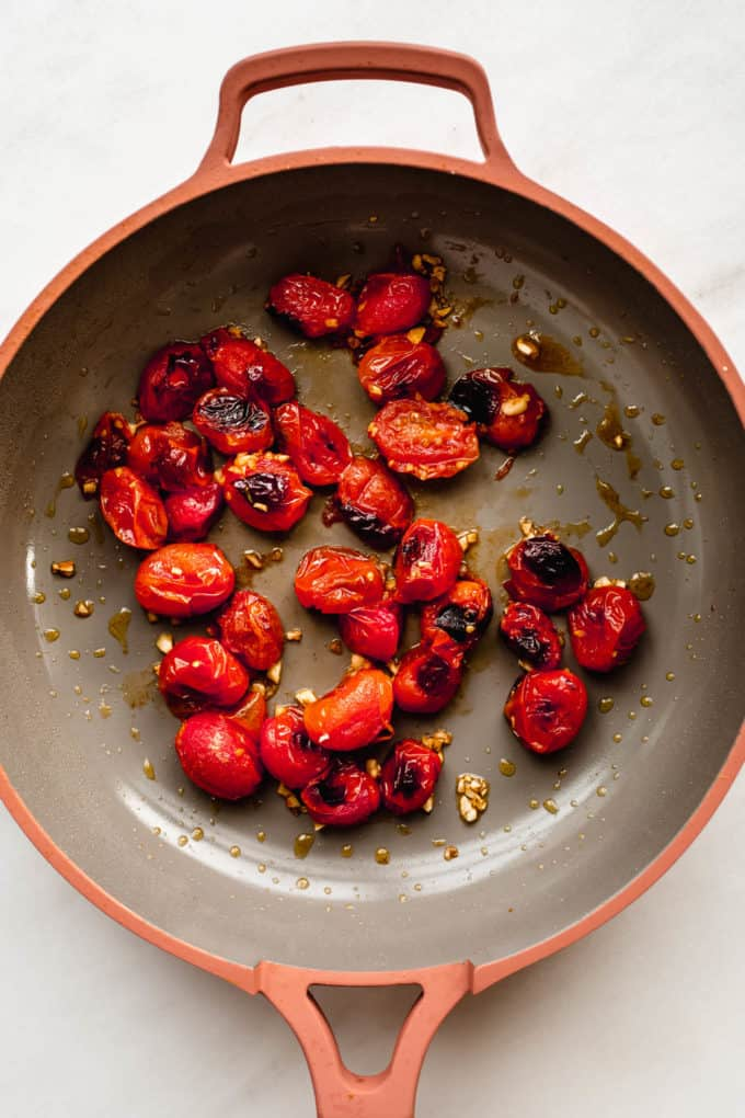 roasted cherry tomatoes and garlic in a pan