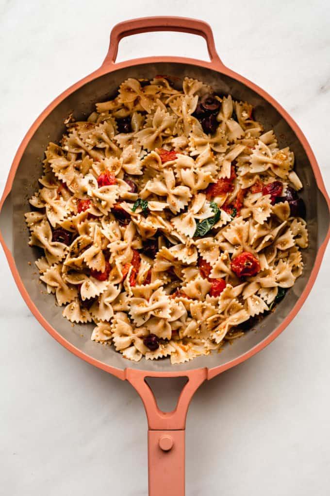 mediterranean farfalle pasta in a pink pan