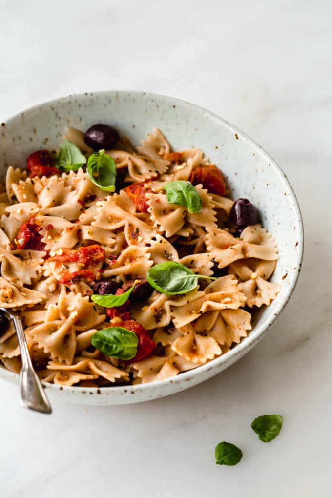 bow-tie pasta in a speckled white bowl