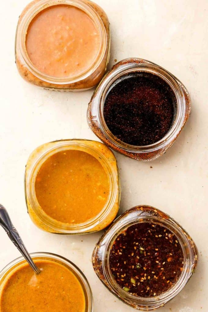5 jars with marinades in them