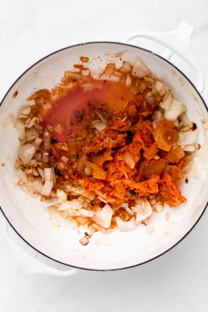 onions, garlic and kimchi in a pot