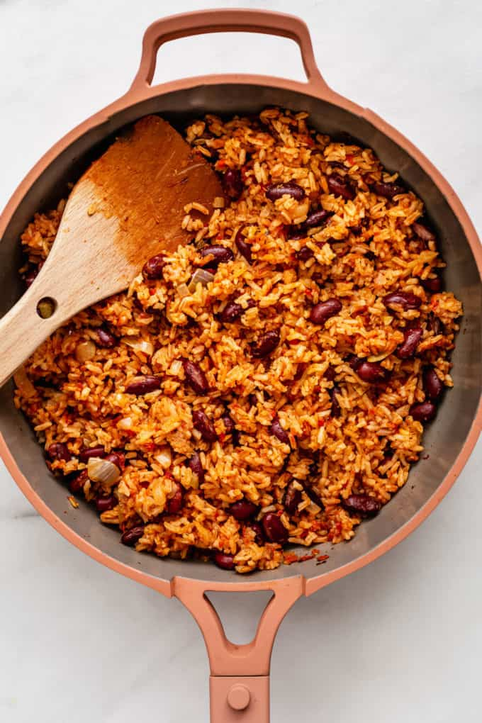 rice and beans in a pink pan