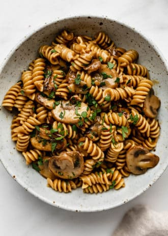 vegan mushroom stroganoff in a white speckled ceramic bowl