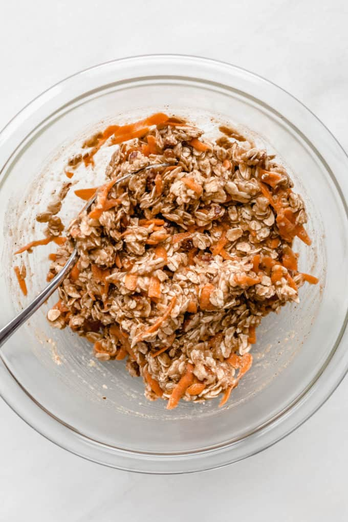 Carrot cake cookie dough in a clear mixing bowl
