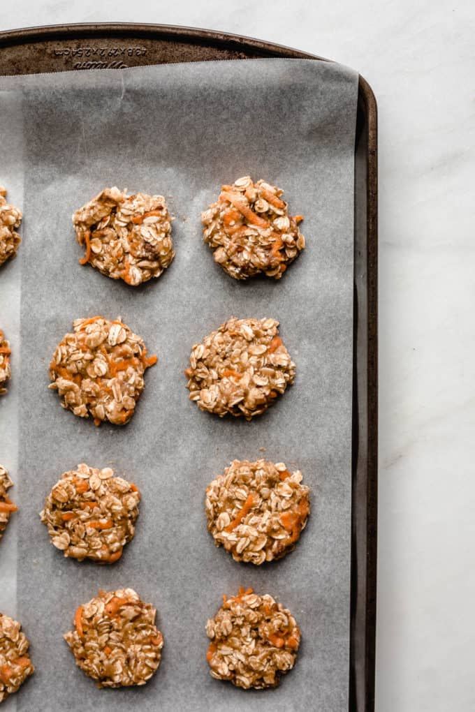 Unbaked carrot cake cookies on a baking sheet