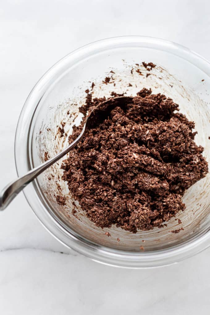 chocolate coconut macaroon dough in a clear mixing bowl