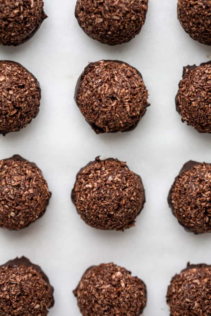chocolate coconut macaroons on a marble board