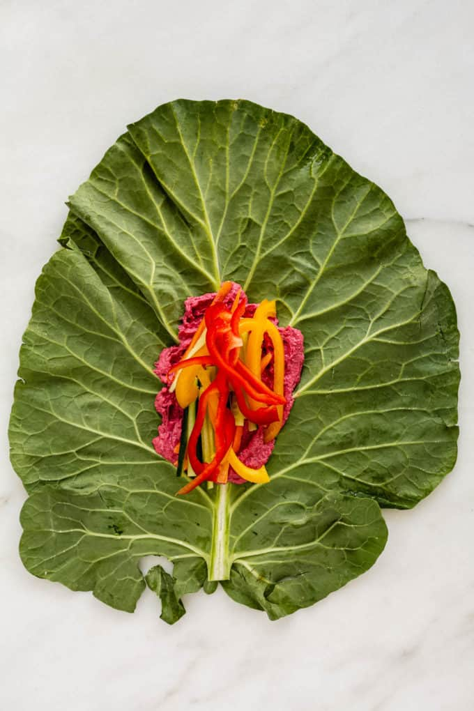 A collard green leaf with peppers on it