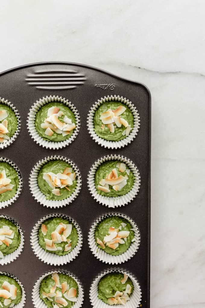 unbaked matcha muffins in a baking pan