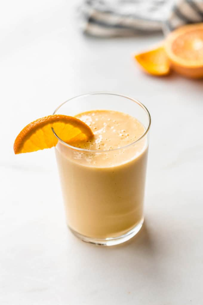 an orange creamsicle smoothie with an orange slice in it