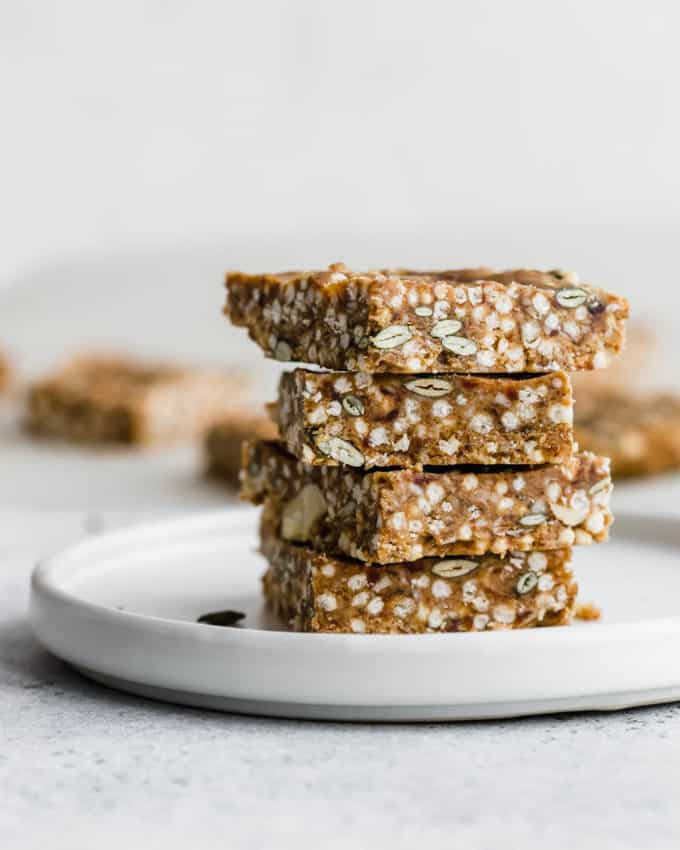 puffed quinoa and nut bars on a white plate