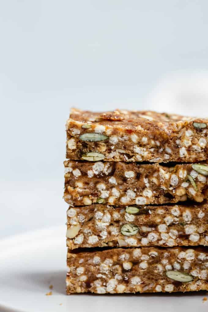 four puffed quinoa and nut bars stacked on top of each other