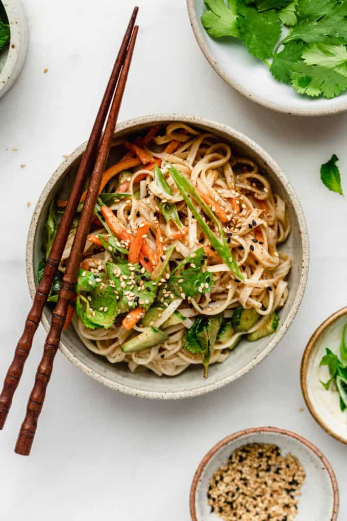 A spring roll noodle bowl tossed in almond butter sauce