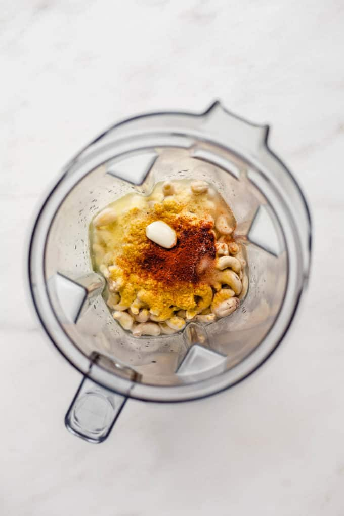 raw cashews, nutritional yeast, garlic and spices in a blender
