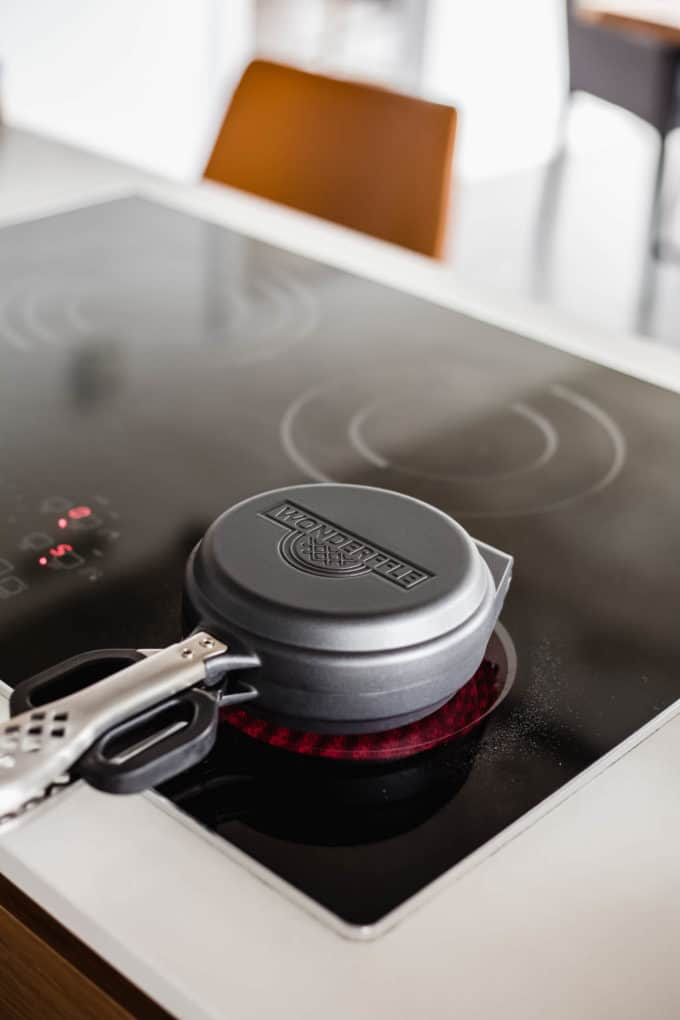a waffle iron on the stove