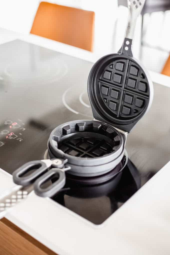 an open waffle iron on the stove