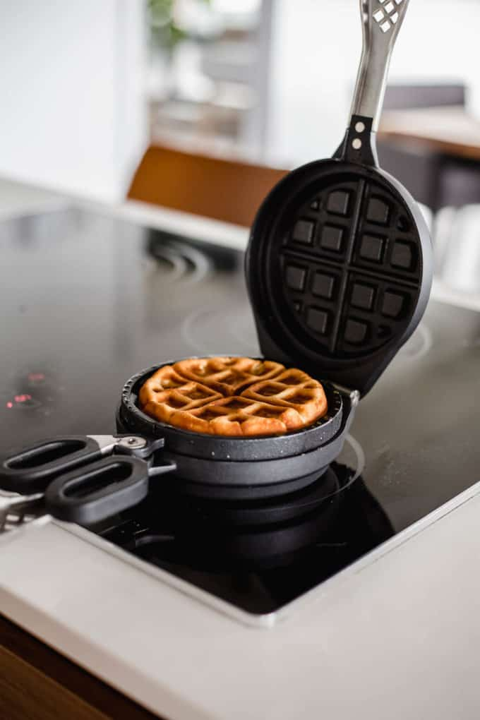 a waffle iron with a cooked waffle in it
