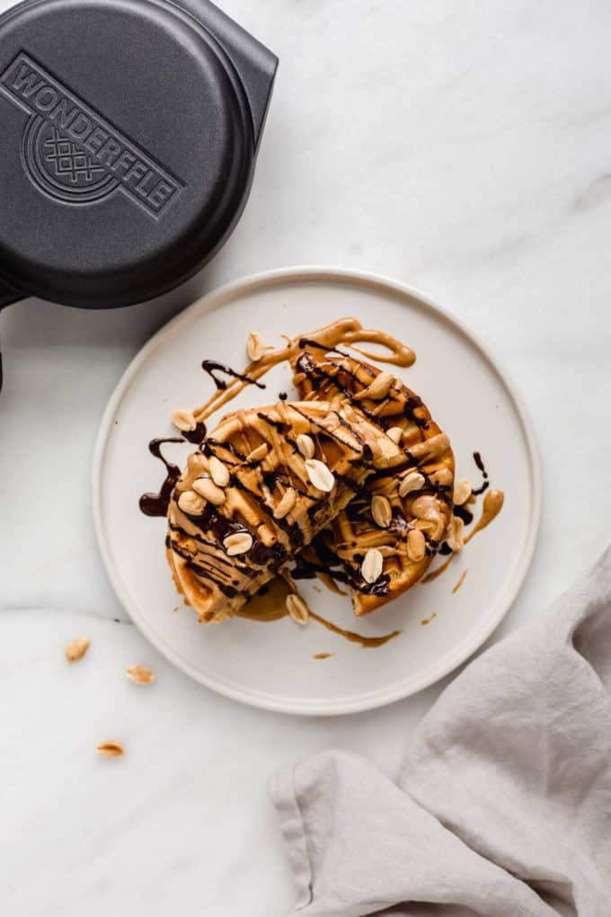 a snickers waffle on a plate with a napkin on the side