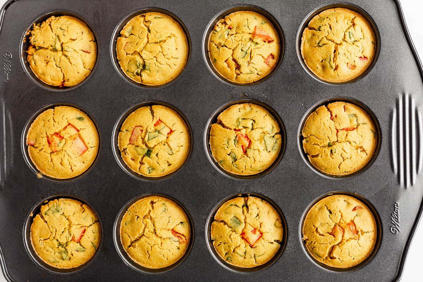 a baking pan with baked mini chickpea flour quiche
