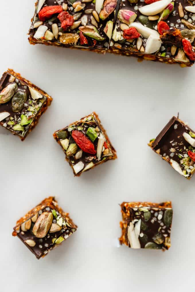 superfood energy bites topped with goji berries and pistachios