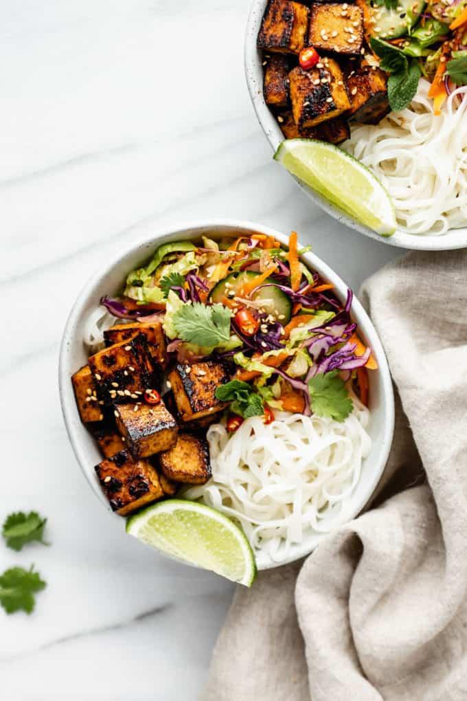 a Vietnamese noodle bowl with lemongrass tofu and a napkin on the side