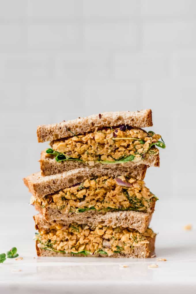 three halves of chickpea salad sandwich stacked