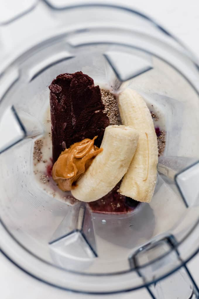 bananas, peanut butter, acai and chia seeds in a blender