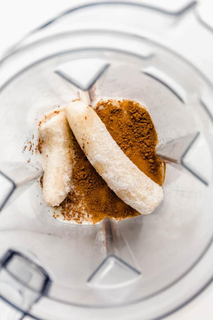 bananas, almond milk and cinnamon in a blender