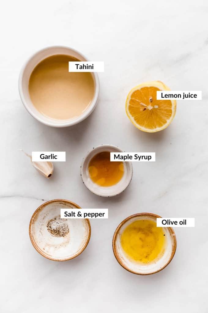 a flat lay of ingredients for lemon tahini dressing
