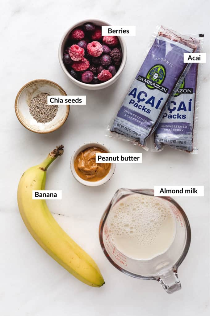 A flat lay of ingredients for an acai smoothie