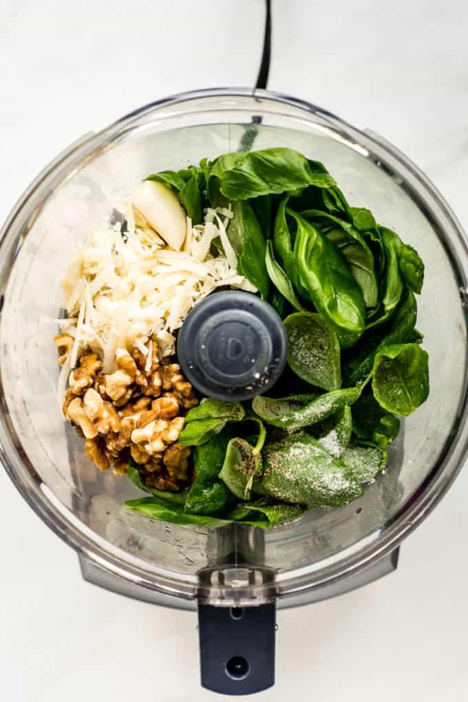 Basil walnuts, garlic and Parmesan cheese in a food processor