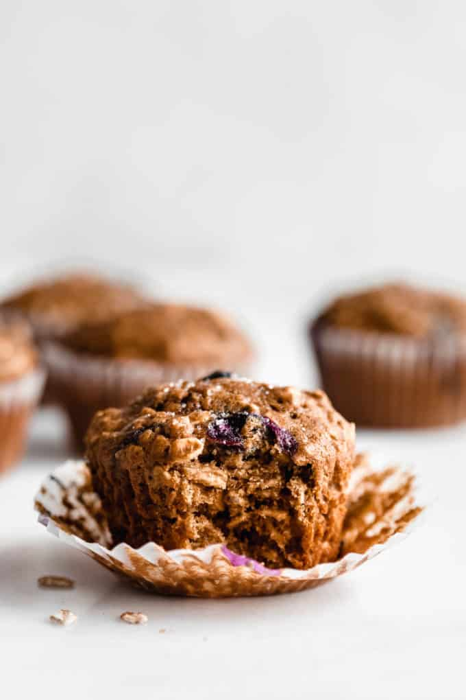 A blueberry muffin with a bite taken out of it