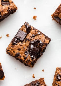 An almond butter blondie topped with chocolate chunks