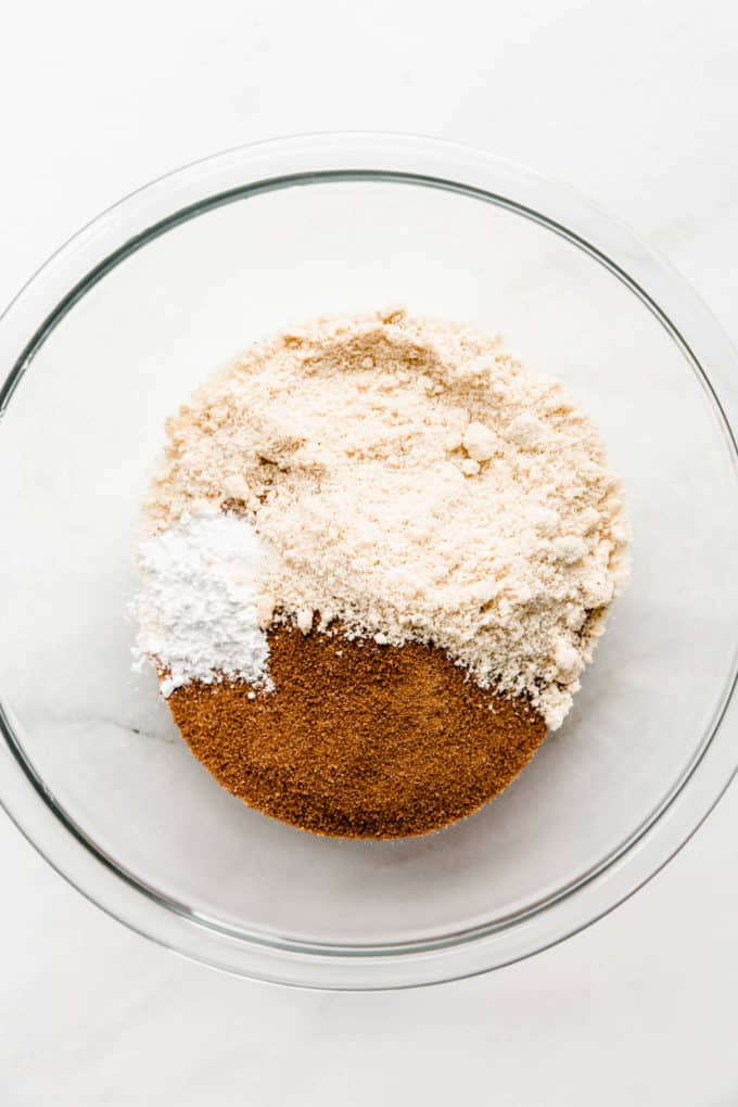 Almond flour and coconut sugar in a clear mixing bowl