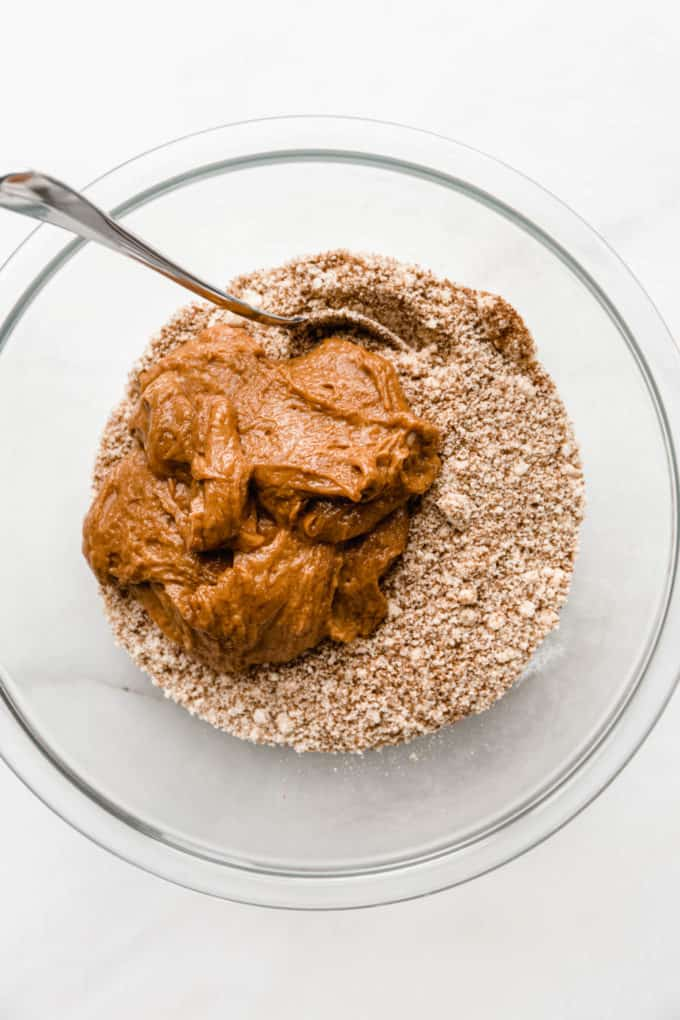 Almond butter and almond flour mixture in a clear mixing bowl