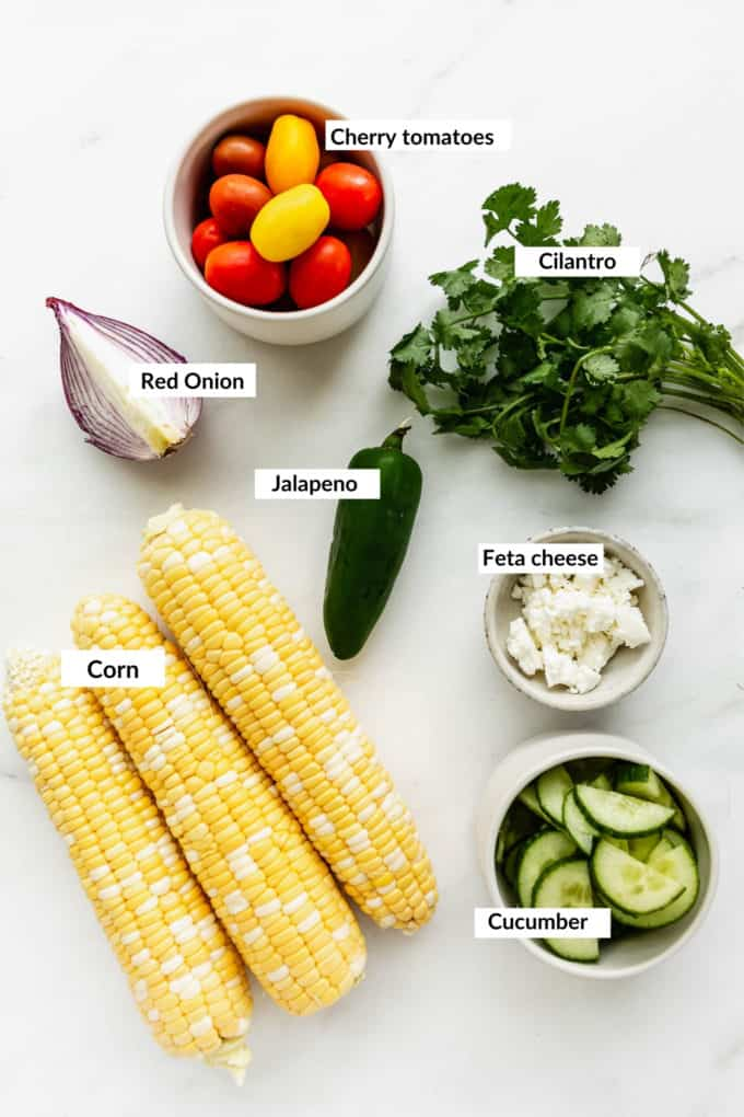 A flat lay of ingredients for corn salad