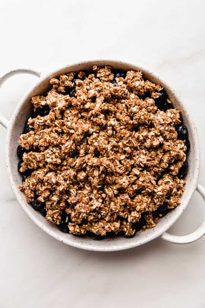 Unbaked blueberry crisp in a baking dish