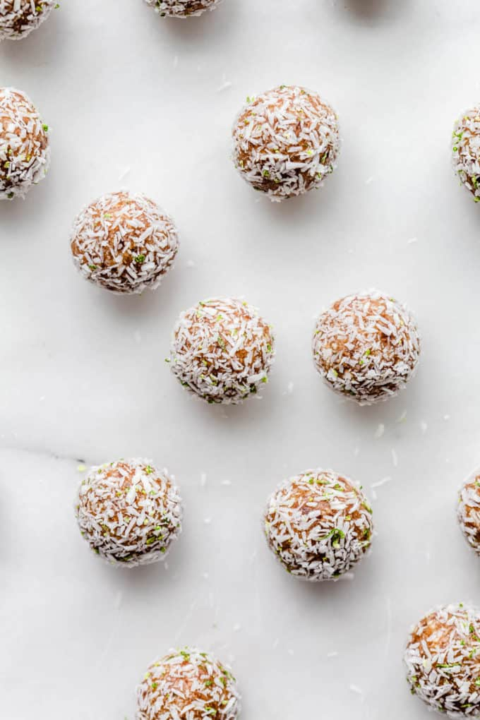 key lime pie energy balls topped with shredded coconut