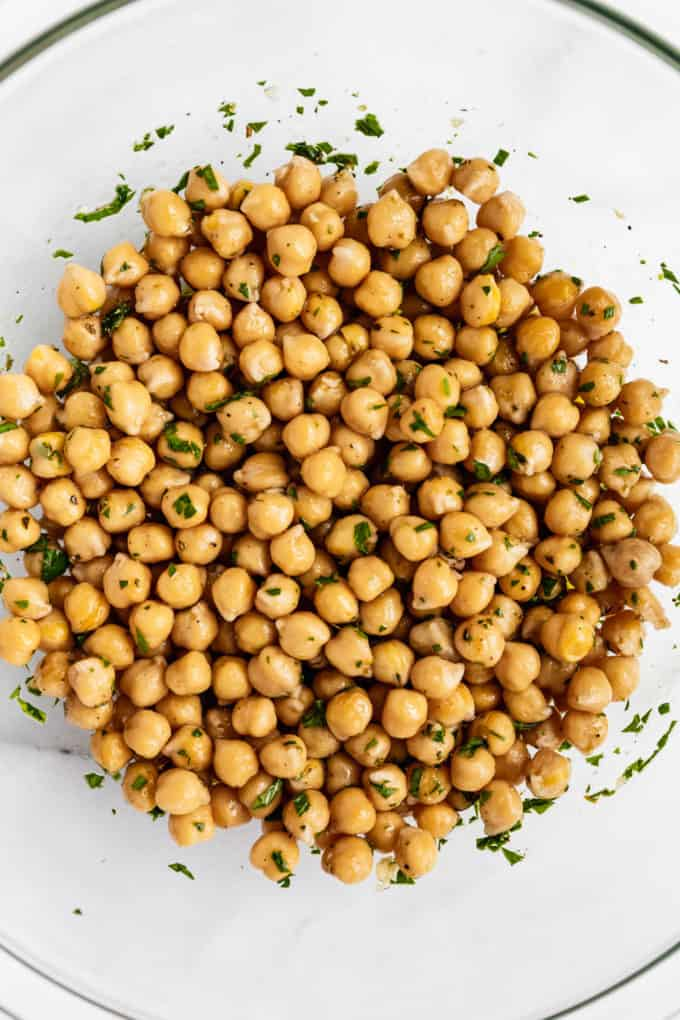 A close up of chickpeas in a mixing bowl