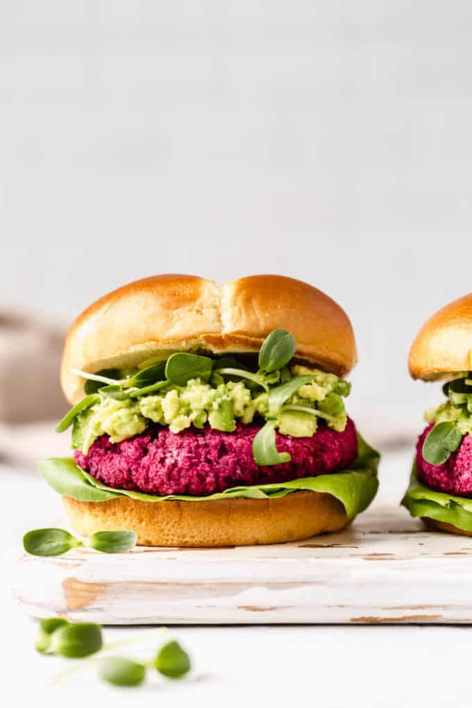 beet burgers on a white wooden serving board