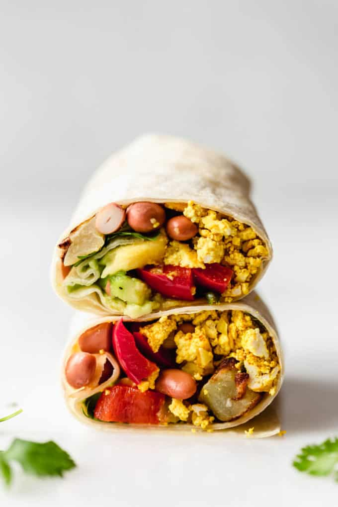 A vegan breakfast burrito stacked on top of each other