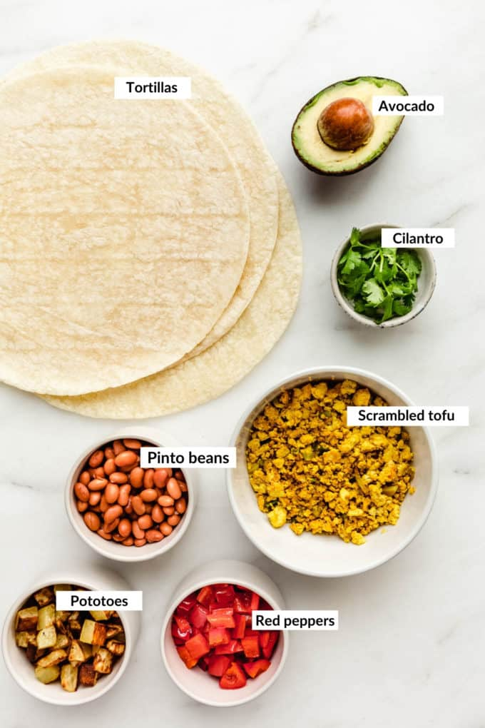 A flat lay of ingredients for vegan breakfast burritos