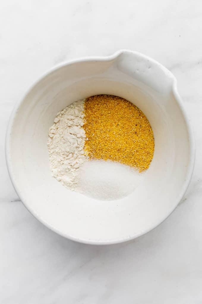 flour, cornmeal and sugar in a bowl