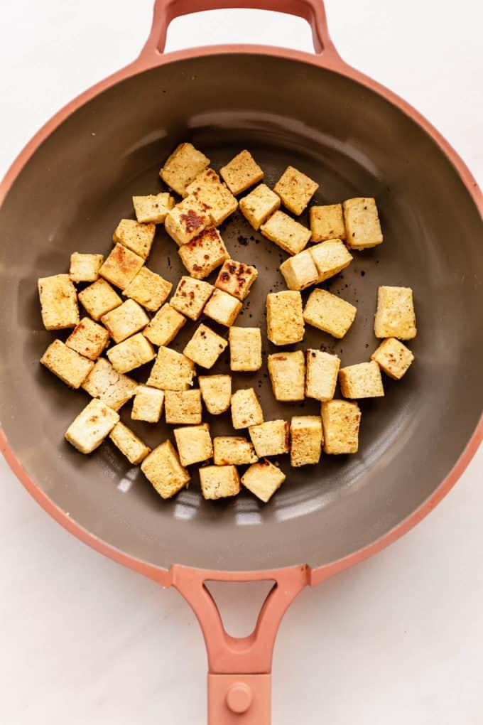 crispy tofu cubes in a pan