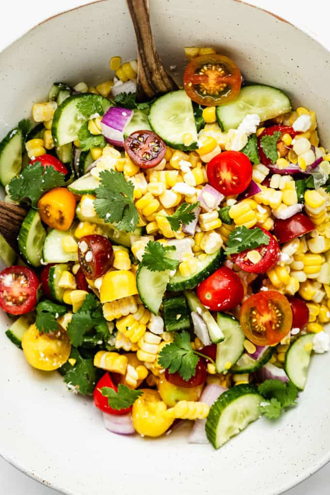 Summer corn salad in a large white bowl